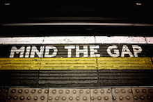 Many UK equity income trusts are now trading at a discount again (illustrated here by a London Underground 'mind the gap' image)