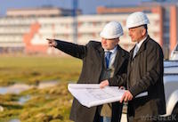 Image of two property men in hard hats.